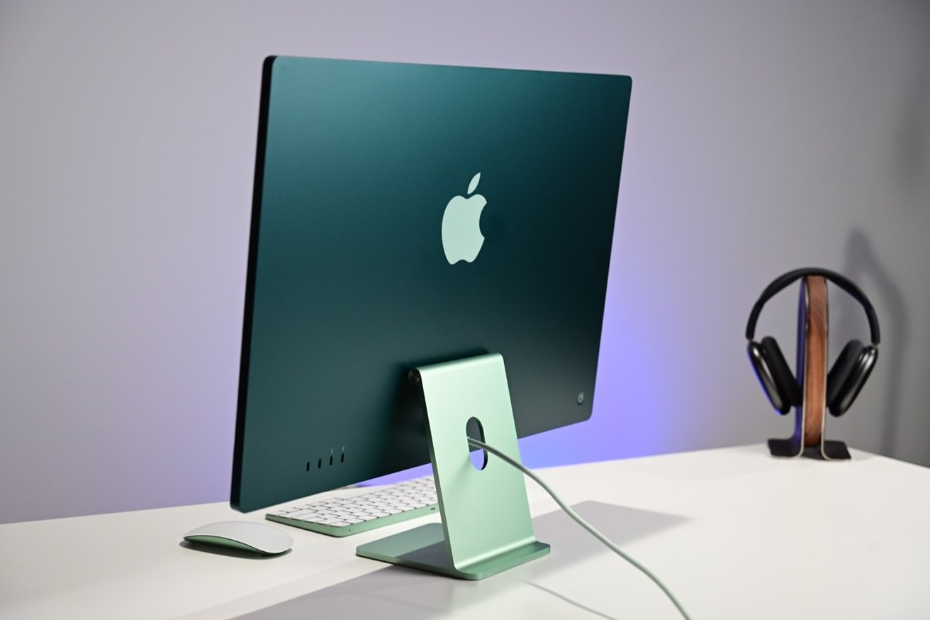 "Тонкий дизайн 24-дюймового iMac особенно хорошо виден сзади. ""loading ="" lazy ""class ="" img-responsive article-image ""/> </div> <p> <span class="
